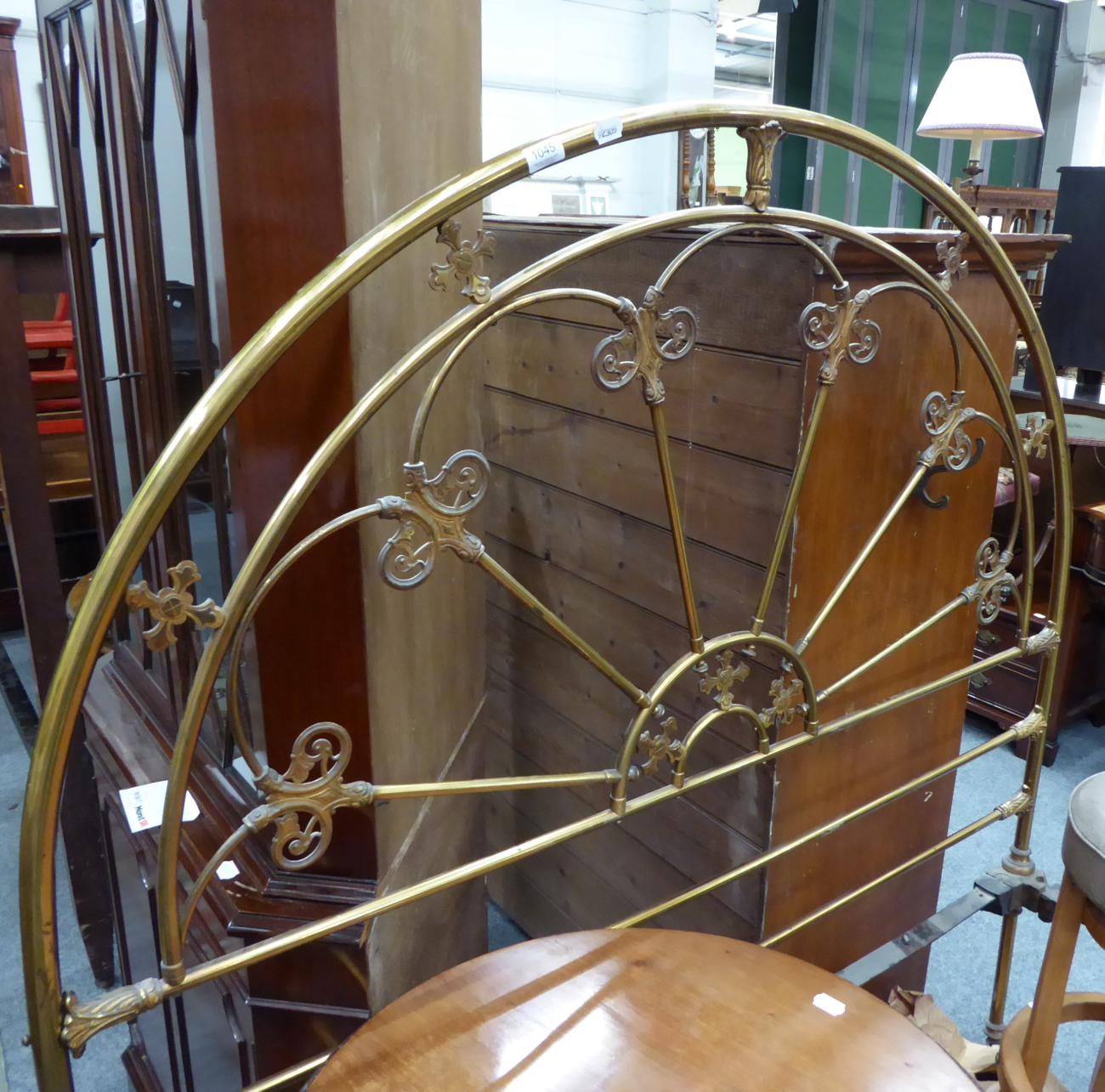 Tennants Auctioneers: A brass bed frame with arched head and foot
