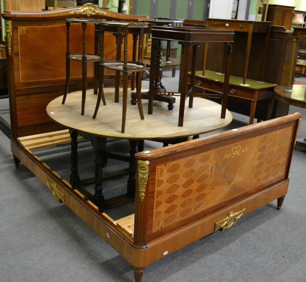 Tennants Auctioneers: A gilt metal mounted and marquetry bed frame in the French taste