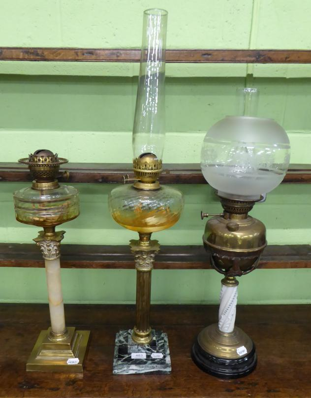 Tennants Auctioneers: Three various oil lamps