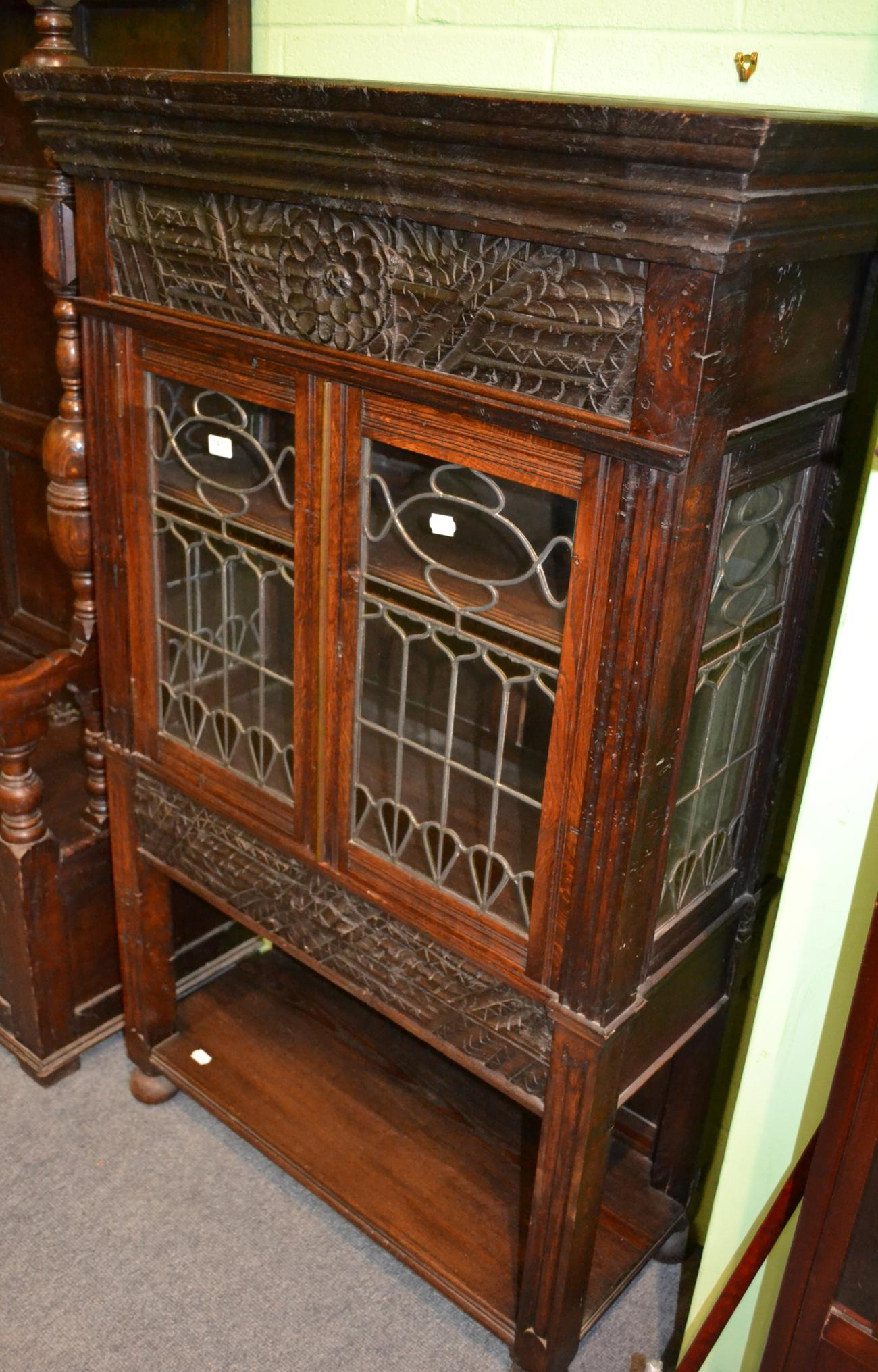 Tennants Auctioneers A Carved Oak Display Cabinet With Leaded Glass Doors Bearing Label Made Of