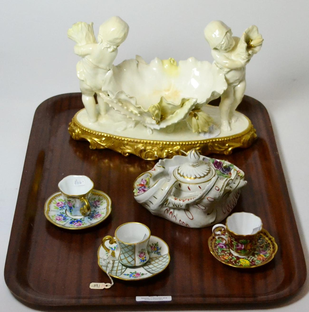 Tennants Auctioneers: A Moore Brothers figural cherub and shell dish