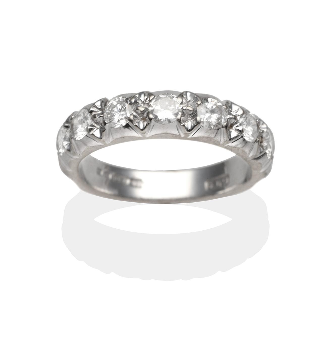 Tennants Auctioneers: An 18 Carat White Gold Diamond Half Hoop Ring