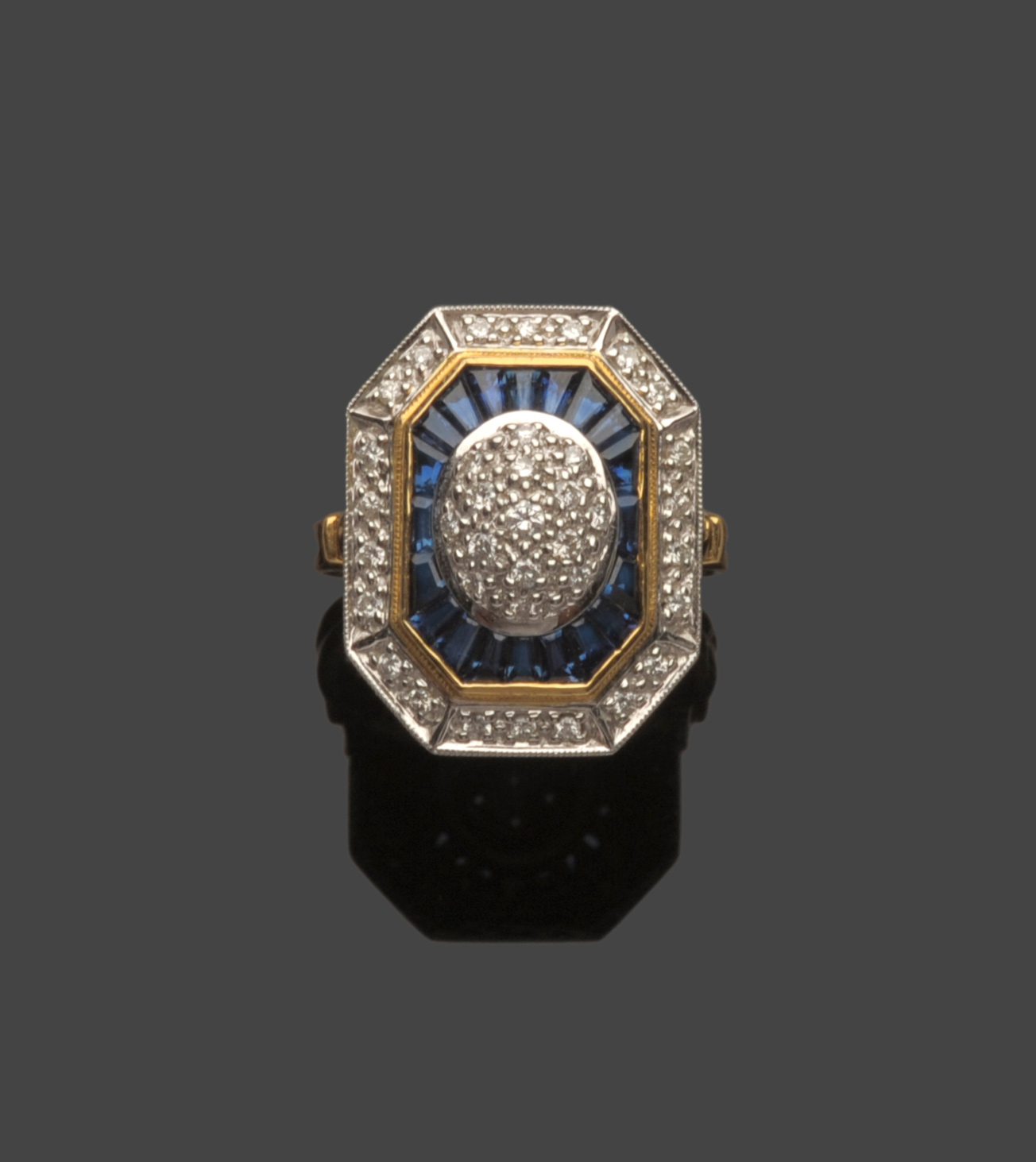 Tennants Auctioneers: An 18 Carat Gold Art Deco Style Diamond and Sapphire Cluster Ring
